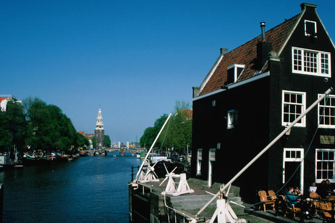 The Prinsengracht canal, leading to the 85 meter tower of the Westerkurk.