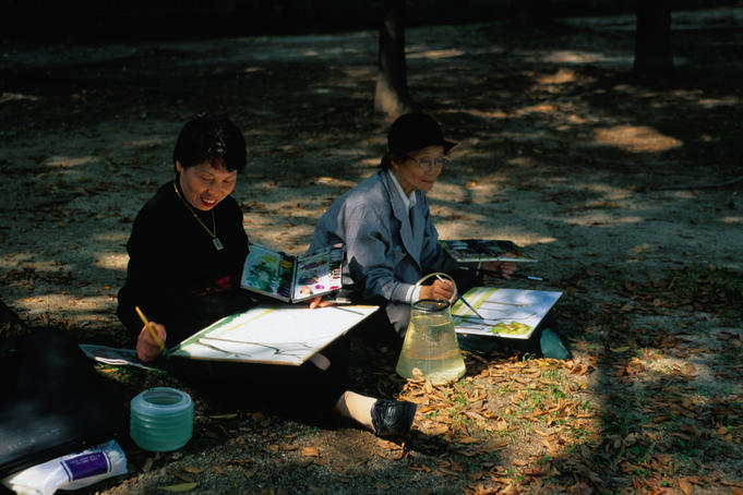 Two women paint watercolours. Seoul's parks are centres of social activity and creativity.