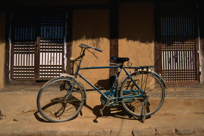 Bicycle outside a traditional mud house in the Hahoe Folk village, a genuine historical village living much as they did in the 16th century.