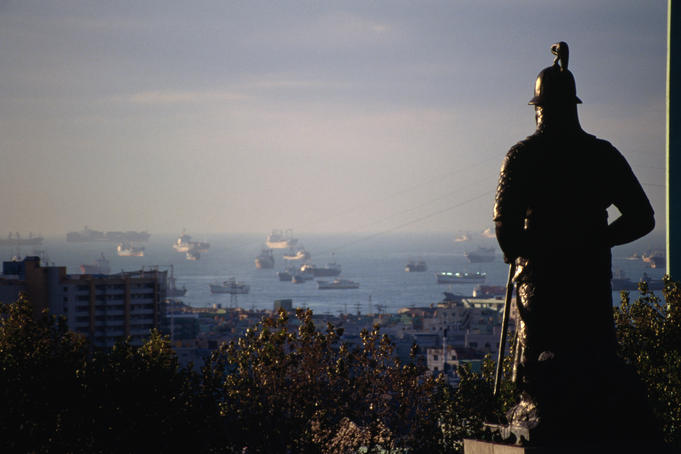 Admiral Yi's bronze statue protectively gazes over the Busan (Pusan) harbour, South Korea's busiest port.