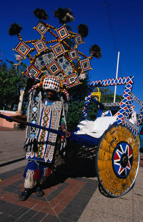 An elaborately decorated rickshaw for tourist hire, a remnant of decades ago when hundreds of rickshaws circulated Durban's beaches