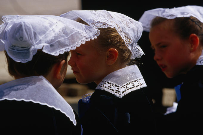 Women in traditional Breton costume watching the Fest Noz parade in Vannes.