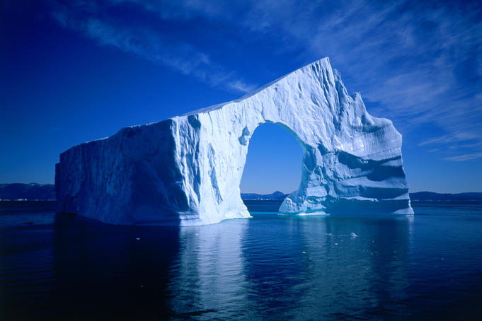 An unusually shaped iceberg with arch, Disko Bay.