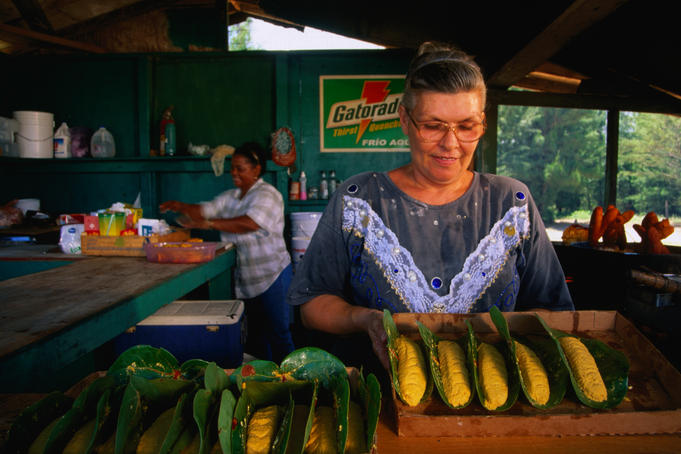 Chef preparing plantains in restaurant in Pinones, near San Juan.