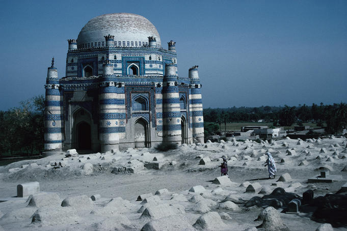 Exterior view of the Mausoleum of Bibi Jawindi ( Gholan Fatima ) with the graveyard in foreground - Uch Sharif, Punjab