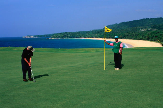 Golfing in Paradise at Playa Grande golf course, designed by Robert Trent Jones ten out of the eighteen holes are on the water's edge, in the San Juan Province.