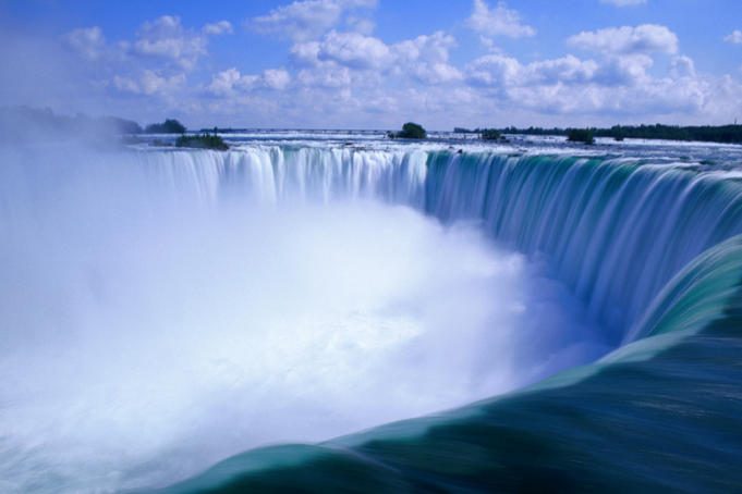 Niagara Falls (Horseshoe Falls) in Ontario. The world's most famous falls span 323 metres in length and stand 57 metres tall. A massive 600,000 litres of water pour over every second.