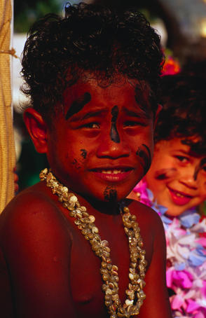 A young boy on the Polynesian float in the Festival of Darwin's grand parade. The August celebration is mainly an outdoor arts and culture festival that highlights Darwin's unique combination of large Asian and Aboriginal populations.