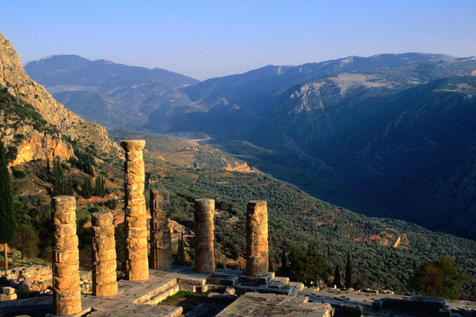 Ruins of the Temple of Apollo and the valley around Mt Parnassos at Delphi.