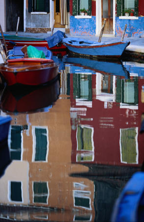 Reflections of Burano, a small island known for its lace industry in Venice