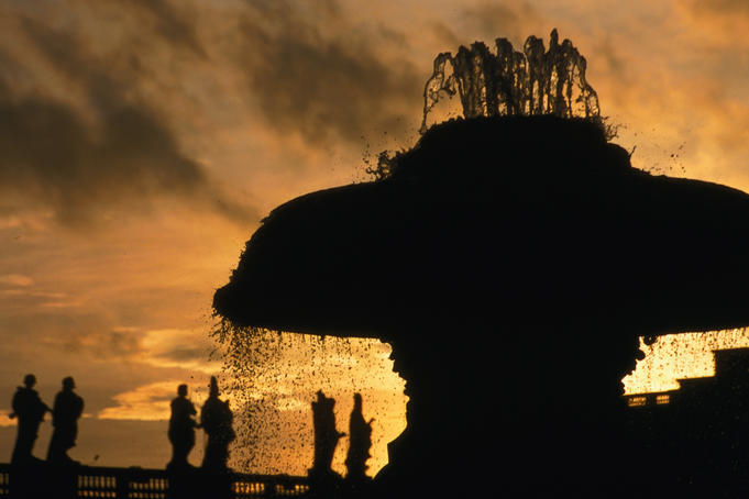 Silhouette of fountain by Carlo Moderno with statues of saints by Bernini, St Peter' s Square.