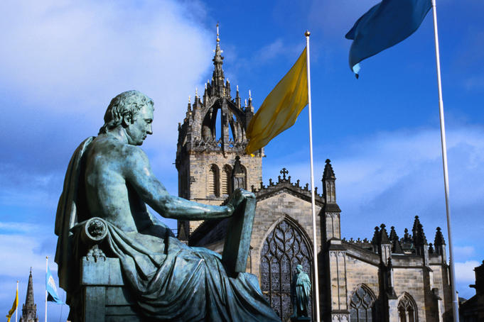 The Hume statue and St Giles Cathedral in Edinburgh, the cathedrals crown spire was completed in 1495