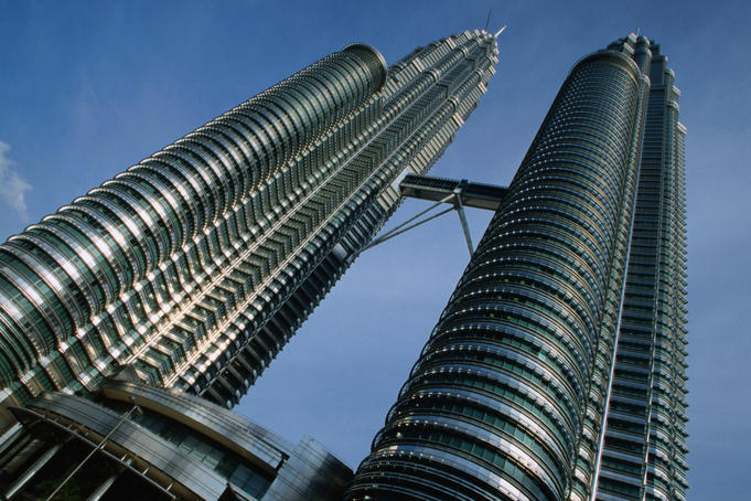 The record breaking twin Petronas Towers in Kuala Lumpur. The 452 metre towers are 7metres taller than Chicago's Sears Tower, and are equivalent to 95 stories each.