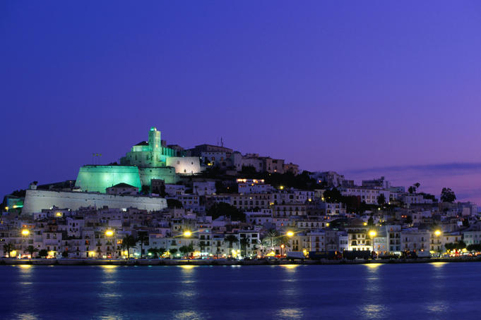 Night view across harbour of Elvissa and old walled town of D'Alt Vila.
