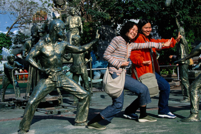 Visitors strike a pose at the Central Movie Studio.