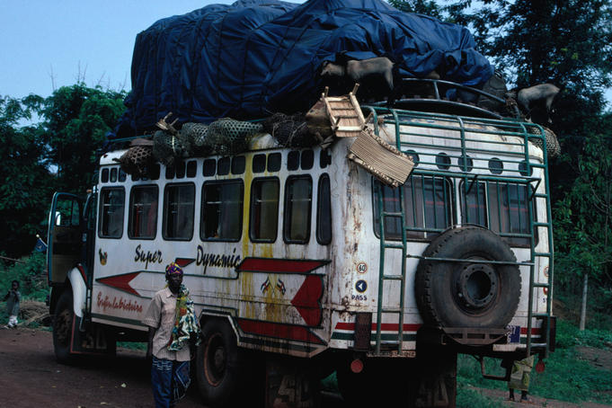 A fully laden local bus, complete with goats: a roadside scene on the journey from Bangui to Kembe Falls.