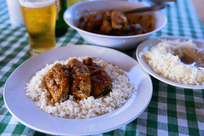 Kingfish vindaloo, rice and an ice cold beer from the Camilson's Beach Resort in Benaulim beach
