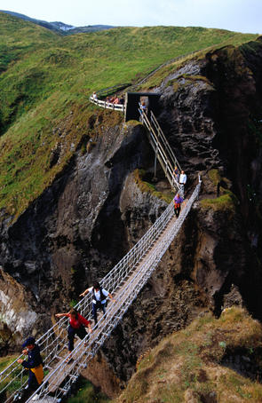 The Carrick-a-rede rope Bridge on the Antrim Coastal Road, many visitors to the bridge freak out and can't make their way back over, a boat takes over from there