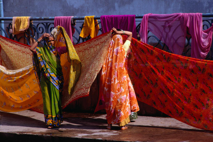 Women hanging saris up to dry after bathing in the sacred tank at Kalighat Hindu Temple, Calcutta.