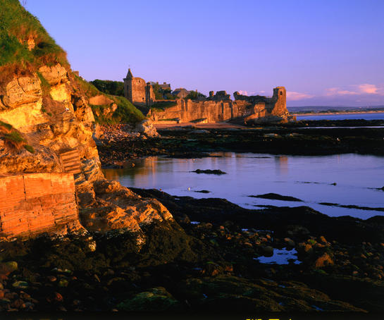 Ruins of St Andrews Castle at dawn.