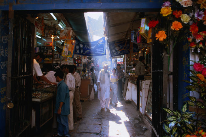 A shaft of light illuminates a local in an alleyway in Chandni Chowk in Old Delhi