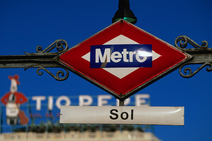 The famous Tio Pepe sign behind the metro sign for Sol in Madrid.
