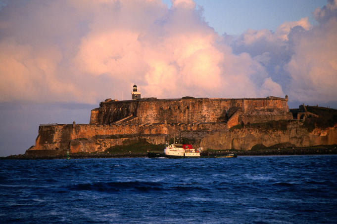 Tugboat passing Fort El Morro.