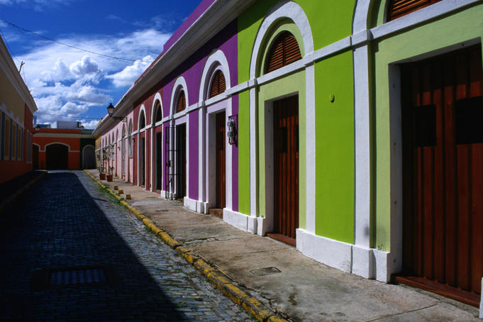 Brilliantly coloured houses on the cobblestoned street leading to Calle (street)Virtud.