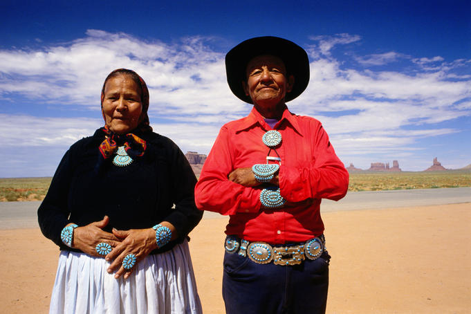 An elderly couple of the Navajo tribe with traditional, beautiful silver and turquoise jewellery.