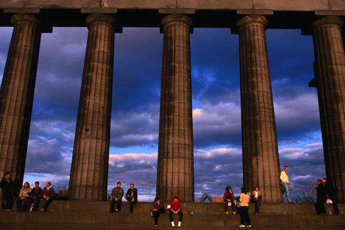 Parthenon National Monument on Calton Hill swarming with tourists in the evening sun, Edinburgh