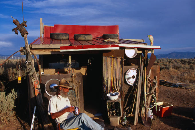 'Cowboy' sitting outside his shack in Taos.