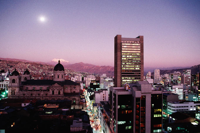 La Paz skyline with snow capped Mount Illimani at dusk. Bolivia's picturesque largest city is home to over half million inhabitants.