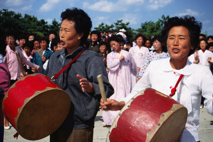 Local people playing drums in Nampo.