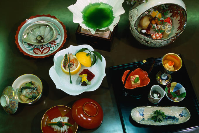 Kaiseki, a stylised banquet which arose from the tea ceremony. Specially chosen bowls and dishes ensure that eating Kaiseki is also a visual banquet- Nadaman restaurant, Tokyo, Japan