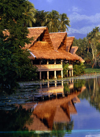 Historical Villa Escudero Plantations and Resort is set amongst tropical coconut trees on a peaceful lake, San Pablo