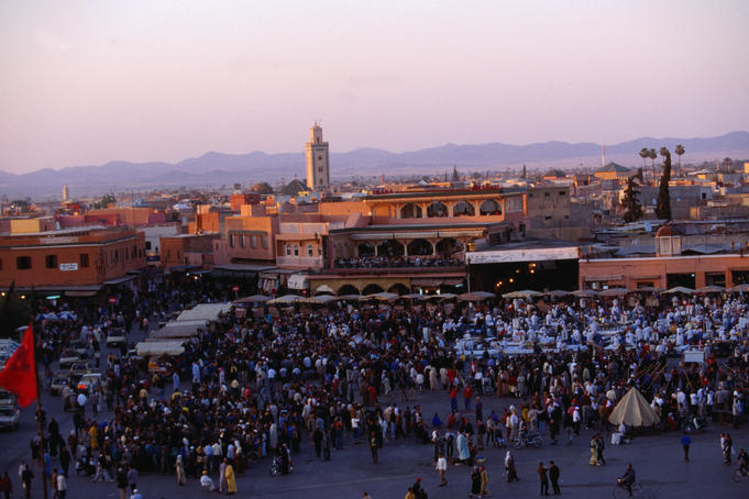 Djemmaa el-Fna, the huge square in the medina of Marrakesh, crammed with a myriad of stalls, performers and spectators.