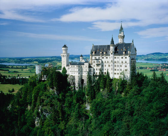 The Neuschwanstein Castle, nestled amongst trees 200 metres above the valley below.