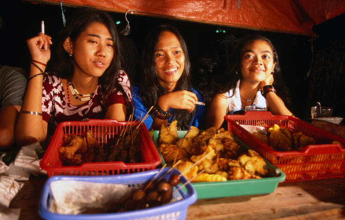 Young women at food stall (warung kopi).