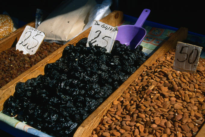 Close up of almonds and dried prunes in the market, Split.
