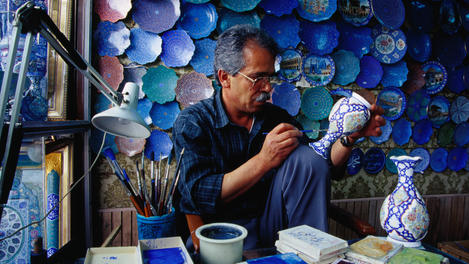 An enamelled copperware artist, Esfahan