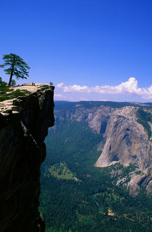 Hikers on Taft Point above Yosemite National Park and El Capitan