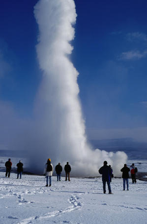 Spectators watching eruption of Stokkur geyser.