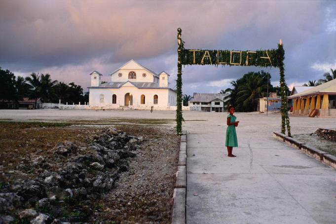 Vaitupu Island, May 2000. Talofa (hello or welcome) sign for the Constitutional Review Committee's (CRC) visit. Vaitupu's church is in the background.