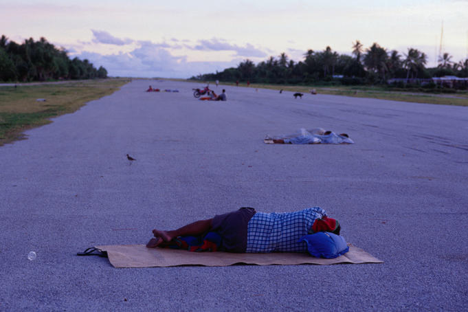 Funafuti Atoll, December 2000. People often sleep on the runway to avoid overcrowded and hot modern houses - at least none of these stories are that dangerous!