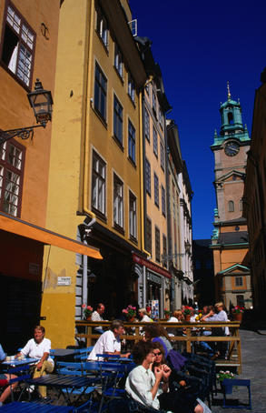 Cafe in the Stortorget square looking towards a corner of the Tyska Kyrkan, a lavishly decorated German church in the Gamla Stan district or Old Town, Stockholm.