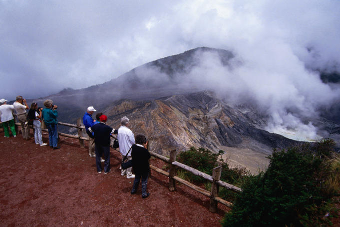 Visitors regard Poas Volcano, a stratovolcano with both an active and a dormant volcano. The crater has been active since 1834.