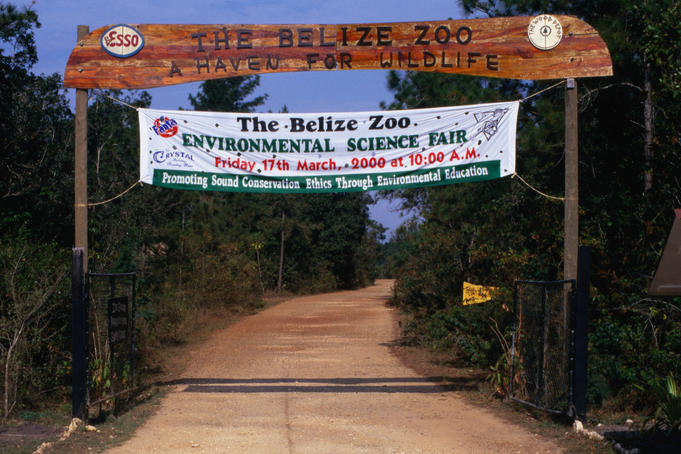 The entrance to Belize Zoo. Set up in 29 acres of tropical savannah it houses over 125 different species of native Belizean animals with an educational emphasis on sustainability and protection.