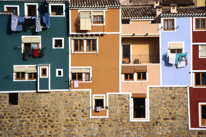 Washing hangging from windows in brightly painted houses in La Vila Joiosa, near Benidorm.