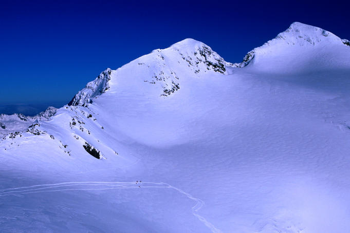 Skier's tracks in the fresh glacier snow at the Alpe d'Huez ski resort - French Alps.