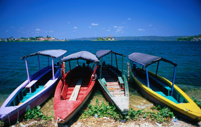 Colourful boats on the shores of Lake Peten.